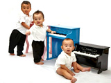 Babies posing with Mini Piano